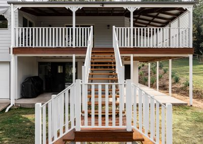 Queenslander staircase and deck with white timber railings