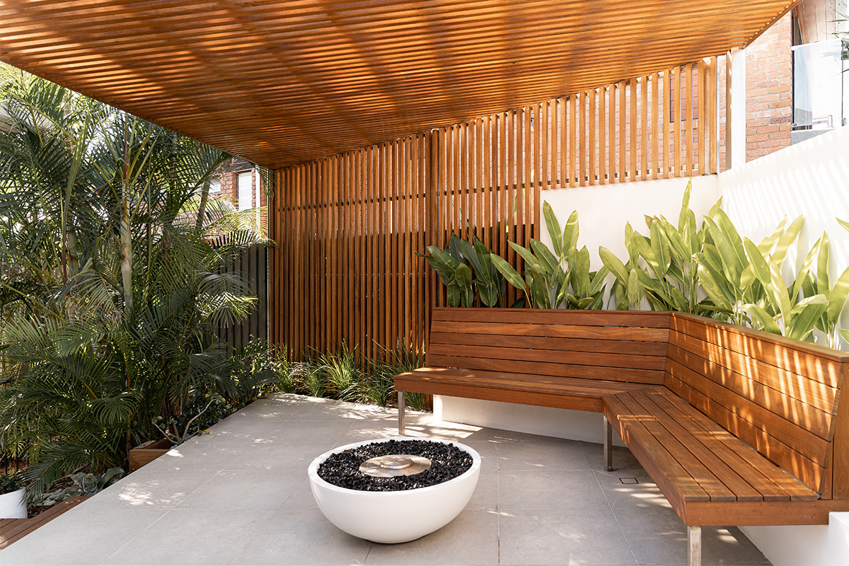 • Outdoor area with custom seating, garden and screening