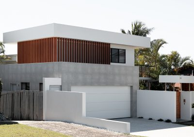 Side view of double storey home with timber feature